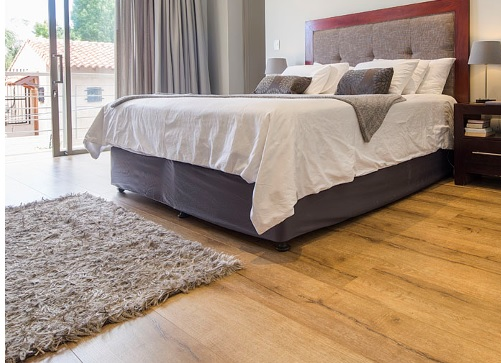 How to stop a bed from moving on laminate floor